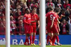 Liverpool's Daniel Sturridge, left, celebrates with teammates after scoring against Southampton during their English Premier League soccer match at Anfield Stadium, Liverpool, England, Sunday Aug. 17, 2014. (AP Photo/Jon Super)
