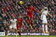 Liverpool's Daniel Sturridge, centre right, scores his second goal against Swansea City during their English Premier League soccer match at Anfield Stadium, Liverpool, England, Sunday Feb. 23, 2014. (AP Photo/Jon Super)