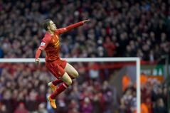Liverpool's Jordan Henderson celebrates after scoring his first goal against Swansea City during their English Premier League soccer match at Anfield Stadium, Liverpool, England, Sunday Feb. 23, 2014. (AP Photo/Jon Super)