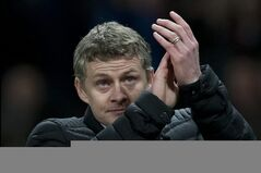 Cardiff City's manager Ole Gunnar Solskjaer applauds supporters after his team's 2-0 loss to Manchester United in their English Premier League soccer match at Old Trafford Stadium, Manchester, England, Tuesday Jan. 28, 2014. (AP Photo/Jon Super)