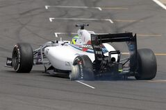Brazil's Felipe Massa of Williams rounds the track with a burst tyre during the British Formula One Grand Prix at Silverstone circuit, Silverstone, England, Sunday, July 6, 2014. Britain's Lewis Hamilton of Mercedes won the race, Finland's Valtteri Bottas of Williams finished second and Australia's Daniel Ricciardo of Red Bull finished third. (AP Photo/Jon Super)
