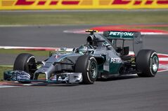 Germany's Nico Rosberg of Mercedes rounds a bend during the British Formula One Grand Prix at Silverstone circuit, Silverstone, England, Sunday, July 6, 2014. Rosberg failed to complete the race due to mechanical failure. Britain's Lewis Hamilton of Mercedes won the race, Finland's Valtteri Bottas of Williams finished second and Australia's Daniel Ricciardo of Red Bull finished third. (AP Photo/Jon Super)