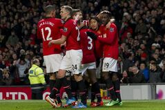 Manchester United's Danny Welbeck, right, celebrates with teammates after scoring against Swansea City during their English Premier League soccer match at Old Trafford Stadium, Manchester, England, Saturday Jan. 11, 2014. (AP Photo/Jon Super)