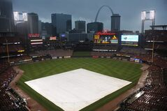 Fog and rain cover the field during a rain delay prior to the St. Louis Cardinals and Boston Red Sox baseball game, Thursday, August 7, 2014, at Busch Stadium in St. Louis. (AP Photo/Bill Boyce)