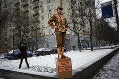 "FILE - In this photo taken on Friday Feb. 7, 2014 a member of pro-Kremlin Young Guards of United Russia photographs a monument to a Nazi soldier outside a building, where the CNN Moscow office is located, as a protest against the CNN poll on the most ugly monuments in the world, which included the WWII monument in Brest, Belarus. U.S. television network CNN caused a firestorm when it included a war monument in Brest, a city in the former Soviet republic of Belarus, in an article on the ""world's ugliest monuments"" published Jan. 24. (AP Photo/Alexander Zemlianichenko, file)"