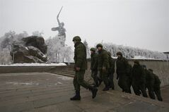 Russian soldiers patrol the Battle of Stalingrad memorial in Volgograd, Russia, Tuesday, Dec. 31, 2013. Russian authorities ordered police to beef up security at train stations and other facilities across the country after a suicide bomber killed 14 people on a bus Monday in the southern city of Volgograd. It was the second deadly attack in two days on the city that lies just 400 miles (650 kilometers) from the site of the 2014 Winter Olympics. (AP Photo/Denis Tyrin)