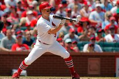 St. Louis Cardinals' Mark Ellis hits a sacrafice bunt to drive in the go-ahead run during the fourth inning of a baseball game against the Philadelphia Phillies, Sunday, June 22, 2014, in St. Louis. (AP Photo/Scott Kane)