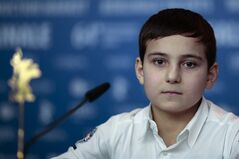 Actor Ramasan Minkailov attends a news conference for the film Macondo during the International Film Festival Berlinale in Berlin, Friday, Feb. 14, 2014. (AP Photo/Markus Schreiber)