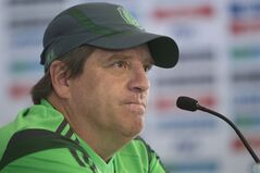 Mexico coach Miguel Herrera attends a press conference after running a training session in Mexico City, Wednesday, May 21, 2014. Mexico will play the World Cup in Brazil in Group A with Brazil, Croatia and Cameroon. (AP Photo/Christian Palma)