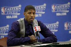 Indiana Pacers forward Paul George talks with the media after Game 1 of the Eastern Conference finals NBA basketball playoff series against the Miami Heat Sunday, May 18, 2014, in Indianapolis. The Pacers won 107-96. (AP Photo/AJ Mast)