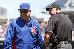 Chicago Cubs manager Rick Renteria departs after speaking with home plate umpire Mike Everitt about a foul ball call, during the third inning of a baseball game at Nationals Park, Sunday, July 6, 2014, in Washington. The play was not reviewed. (AP Photo/Alex Brandon)