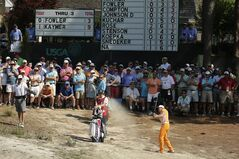 Rickie Fowler hits from the natural area on the fourth hole during the final round of the U.S. Open golf tournament in Pinehurst, N.C., Sunday, June 15, 2014. (AP Photo/Charlie Riedel)