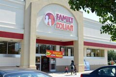 In this Tuesday, July 29, 2014 photo, customers enter a Family Dollar store on Plaza Boulevard, in Kinston, N.C. There's now a bidding war for Family Dollar, with Dollar General offering about $9.7 billion for the discounter in an effort to trump Dollar Tree's bid of $8.5 billion. (AP Photo/Kinston Free Press, Janet S. Carter)