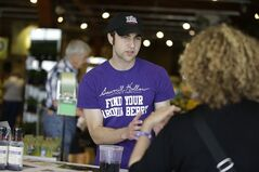 Andrew Pittz of the Sawmill Hollow aronia berry farm offers samples and sells aronia berry products at Whole Foods Market in Omaha, Neb., Friday, April 25, 2014. A few years ago, few people had ever heard of the Aronia berry, a pretty, but tart fruit. Now, the berry has set its sights on becoming the next