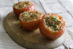 This June 30, 2014 photo shows cheese stuffed tomatoes in Concord, N.H. (AP Photo/Matthew Mead)