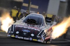 In this photo provided by NHRA, Funny Car driver Courtney Force secures the No. 1 qualifying position at the NHRA Sonoma Nationals drag races at Sonoma Raceway on Friday, July 25, 2014, in Sonoma, Calif. (AP Photo/NHRA, Marc Gewertz)