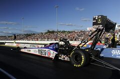 In this photo provided by NHRA, Antron Brown begins a qualifying run on Friday, June 20, 2014, for the Auto-Plus NHRA New England Nationals drag races at New England Dragway in Epping, N.H. Brown raced to the provisional No. 1 qualifying spot with a 3.770-second run at 323.58 mph. (AP Photo/NHRA, Marc Gewertz)