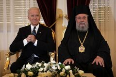 US Vice President Joe Biden, left, and Cyprus' Greek Orthodox Archbishop Chrysostomos II are seen during a meeting at the Archbishopric in divided capital Nicosia, Cyprus, on Thursday, May 22, 2014. Biden met with the ethnically divided island's religious leaders including Turkish Cypriot Muslim Grand Mufti Talip Atalay, Maronite Archbishop Youssef Soueif, Armenian Archbishop Varoujan Herkelian and Father Mariusz Dulniok, Latin Parish Priest in Cyprus. The meetings are part of the US vice president's contacts during his two-day trip to Cyprus which he hailed as Washington's strategic partner and expressed strong support for talks to reunify the country. (AP Photo/Petros Karadjias, Pool)