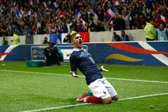 French soccer team forward Antoine Griezmann, reacts after scoring against Paraguay during their friendly soccer match, at the Allianz Riviera Stadium, in Nice, southeastern France, Sunday, June 1, 2014. France is preparing for the upcoming soccer World Cup in Brazil starting on 12 June. (AP Photo/Claude Paris)