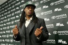 Calvin Pryor, who was drafted by the New York Jets with the 18th pick in the first round of the NFL football draft the night before, waits for instructions after a news conference, Friday, May 9, 2014, in Florham Park, N.J. (AP Photo/Julio Cortez)