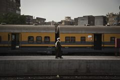 An Egyptian man walks at the main train station in Cairo, Egypt, Monday, April 8, 2013. A union of Egypt's train drivers and conductors announced on Sunday April 7, 2013 that they have gone on strike, the latest in a seemingly endless series of work stoppages to hit the country in the past two years.The strike began, hours after authorities approved a 10 percent hike in the allowance routinely given to train drivers and conductors. The raise was rejected as too little. (AP Photo/Nariman El-Mofty)