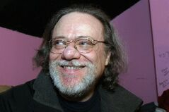 FILE - In this Jan. 8, 2005, file photo, Tommy Ramone, ex-drummer and manager of The Ramones, smiles as he is interviewed backstage at the Knitting Factory in New York. A business associate says Ramone, a co-founder of the seminal punk band The Ramones and the last surviving member of the original group, has died. Dave Frey, who works for Ramones Productions and Silent Partner Management, says Ramone's wife called to tell him he died on Friday, July 11, 2014. Ramone was 62. (AP Photo/Tina Fineberg, File)