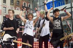 FILE - In this Tuesday, July 22, 2014 file photo, 5 Seconds of Summer band members, from left, Luke Hemmings, Ashton Irwin, Michael Clifford and Calum Hood appear on NBC's