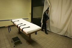 FILE - In this Nov. 2005 file photo, public information director Larry Greene is shown in the death chamber at the Southern Ohio Correctional Facility in Lucasville, Ohio. Warden Donald Morgan says the state's execution table can easily hold Ronald Post, scheduled to be executed in January 2013, who has argued arguing that because of his obesity, an attempt to put him to death would amount to cruel and unusual punishment. (AP Photo/Kiichiro Sato, File)