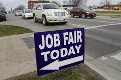 In this April 10, 2014, photo, a sign points to a job fair on the campus of Kaplan University in Lincoln, Neb. At first glance, April's U.S. employment report suggested that the agonizingly slow 5�-year-old economic recovery has gained new momentum. Yet several cautionary signs emerged from the report. (AP Photo/Nati Harnik)