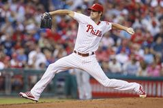 FILE - In this Aug. 7, 2013 file photo, Philadelphia Phillies' Cole Hamels throws a pitch during the third inning of a baseball game in Philadelphia. Hamels said he won't be able to make his opening day start after feeling discomfort in his pitching arm during the offseason. (AP Photo/Christopher Szagola, File)