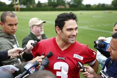 FILe - In this May 29, 2014 file photo, Philadelphia Eagles quarterback Mark Sanchez speaks with members of the media after an NFL football organized team activity in Philadelphia. Matt Barkley followed Mark Sanchez to USC and set school records in nearly every statistical passing category. The former Trojans are teammates now and they're battling for the same job. (AP Photo/Matt Rourke, File)