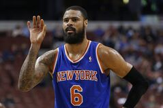In this March 21, 2014, photo, New York Knicks' Tyson Chandler gestures during an NBA basketball game against the Philadelphia 76ers in Philadelphia. The Dallas Mavericks and the Knicks have agreed to a trade that would bring center Chandler back to the Mavericks three years after he helped them win a championship only to leave right away in free agency. Two people with knowledge of the deal said Wednesday, June 25, 2014, the Mavericks would send guards Jose Calderon and Shane Larkin and center Samuel Dalembert to the Knicks for Chandler and point guard Raymond Felton. The people spoke on condition of anonymity because the deal hasn't been announced. (AP Photo/Matt Slocum)