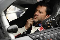 FILE - In this April 7, 2014, file photo, Tony Stewart prepares to start a NASCAR Sprint Cup series auto race at Texas Motor Speedway in Fort Worth, Texas. Stewart will return to Sprint Cup competition Sunday night at Atlanta Motor Speedway, ending a three-race hiatus taken after he struck and killed a fellow driver during a dirt-track race. (AP Photo/Ralph Lauer, File)