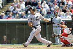 ADVANCE FOR WEEKEND EDITIONS, MAY 17-18 - FILE - In this May 4, 2014 file photo, Chicago White Sox's Jose Abreu (79) watches his home run against the Cleveland Indians in a baseball game in Cleveland. Some 5,000 feet of homers in just six weeks, another successful mile in a bridge that runs from Abreu's native Cuba to the Chicago White Sox. (AP Photo/Mark Duncan, File)