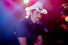 American country singer-songwriter and musician Brad Paisley poses for a portrait, Thursday, Aug. 28, 2014, in New York. Paisley cranks up the fun and avoids controversy on his new album