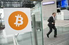 FILE - In this April 7, 2014 file photo, a man arrives for the Inside Bitcoins conference and trade show in New York. The Bitcoin digital currency system is in danger of losing its credibility as an independent payment system because of the growing power of a group that runs the some of the computers behind it. (AP Photo/Mark Lennihan, File)