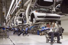 FILE - In this July 12, 2013, photo, employees at the Volkswagen plant in Chattanooga, Tenn., work on the assembly of a Passat sedan. Volkswagen on Monday, July 14, 2014 said it will build a new seven-passenger SUV at the Chattanooga factory, adding about 2,000 jobs. (AP Photo/Erik Schelzig, File)