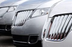 In this photo made on Thursday, June 5, 2014, a row of 2014 Lincoln MKX SUVs are lined up on the lot of the dealership in Wexford, Pa. General Motors, Ford, Nissan and Chrysler all reported big gains as the major automakers reported July sales Friday, Aug. 1, 2014. (AP Photo/Keith Srakocic)