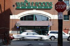 FILE - In this March 25, 2014, file photo, shows a Whole Foods store in Philadelphia. Whole Foods reports quarterly earnings on Tuesday, May 6, 2014. (AP Photo/Matt Rourke, File)