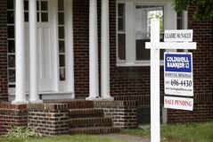 This July 10, 2014 photo shows a house with sale pending sign in Quincy, Mass. The National Association of Realtors releases pending home sales index for July on Thursday, Aug. 28, 2014. (AP Photo/Michael Dwyer)