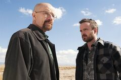 This image released by AMC shows Bryan Cranston as Walter White, left, and Aaron Paul as Jesse Pinkman in a scene from