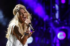 FILE - This June 9, 2013 file photo shows Carrie Underwood performing at the 2013 CMA Music Festival in Nashville, Tenn. On Sept. 8, Underwood will sing
