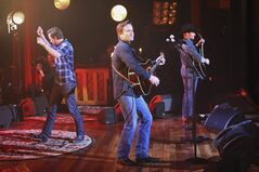 This image released by ABC shows, from left, Will Chase, Charles Esten and Chris Carmack performing on a special
