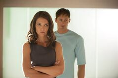 This image released by The Weinstein Company shows Katie Holmes, left, and Alexander Skarsgard in a scene from