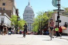 This undated image provided by the Greater Madison Convention & Visitors Bureau shows bicyclists on State Street in Madison, Wis. State Street runs about three-quarters of a mile from the state Capitol to the University of Wisconsin campus. The thoroughfare is car-free except for delivery trucks and buses, attracting a mix of undergrads, locals and government workers for shopping, dining and people-watching. (AP Photo/ Greater Madison Convention & Visitors Bureau, John Maniaci)