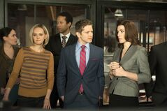 This image released by CBS shows, front row from left, Jess Weixler, Matt Czuchry and Julianna Margulies in a scene from