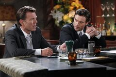 This image released by CBS shows Peter Bergman, left, and Daniel Goddard in a scene from