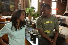 This image released by Universal Pictures shows Tika Sumpter, left, and Kevin Hart in a scene from