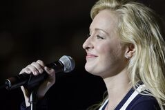 FILE - This Nov. 14, 2008 file photo shows country singer Mindy McCready performsing in Nashville, Tenn. McCready's family has planned a private funeral service to be held Tuesday, Feb. 26, 2013 in Fort Myers, Fla. McCready, who hit the top of the country charts before personal problems sidetracked her career, died Sunday, Feb. 17. She was 37. (AP Photo/Mark Humphrey, File)