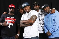 This Aug. 20, 2014 photo shows American rapper, entrepreneur and actor 50 Cent, center, posing for a portrait with G-Unit members Young Buck, Lloyd Banks, Tony Yayo and Kidd Kidd in New York. (Photo by Brian Ach/Invision/AP)